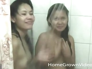 Two hot Asian babes enjoy a threesome probe they shower together