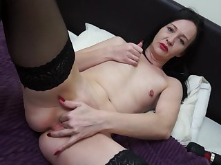 Dark haired mature MILF Lolani strips and masturbates matey