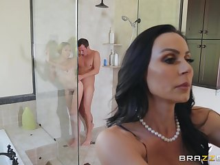 Kendra Lust blowing her friend's oversize dick during a trine