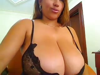Now that's what I call a nice rack and this buxom goddess loves her toys
