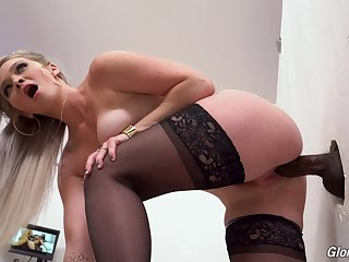 Slutty blonde in all directions stockings Kay Carter enjoys visiting glory hole enclosure