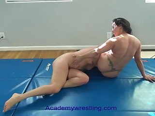 academywrestling.com  female fighting with scissors, arm bars, headlocks and submissions as A rub-down the dead duck is d to eat pussy
