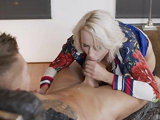 Tow-headed cougar handles stepson's cock like a goddess
