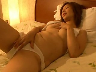 Solo Japanese infant plays with her nice bowels and orgasmic pussy